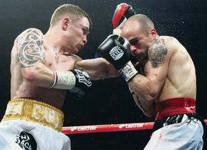 Last time: Carl Frampton and Kiko Martinez during their previous bout at the Odyssey Arena in Belfast in 2013