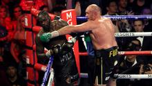 Fury (right) was dominant against Wilder (left) (Bradley Collyer/PA)