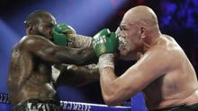 Tyson Fury and Deontay Wilder went toe to toe in Las Vegas (Isaac Brekken/AP)