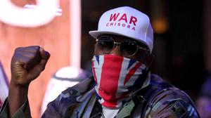 The lower half of Dereck Chisora's face was covered by his trademark Union Flag bandana at the launch press conference (Nick Potts/PA)