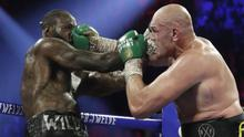 Deontay Wilder and Tyson Fury appear set to go head to head for a third time (Isaac Brekken/AP)