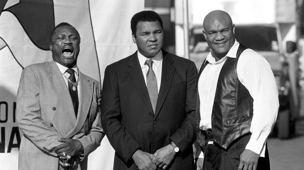 It is 50 years since Muhammad Ali faced Joe Frazier – pictured with George Foreman – for the first time (PA Archive)