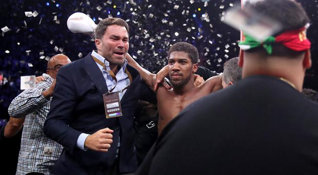 Eddie Hearn (left) said Anthony Joshua had proved his doubters wrong (Nick Potts/PA)