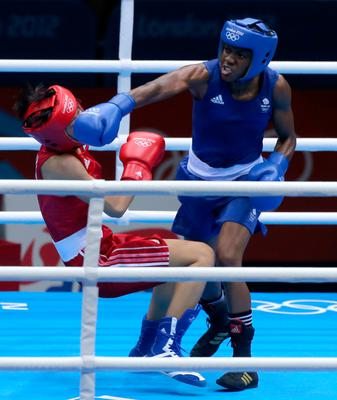 Final countdown: Nicola Adams knocks down China's Cancan Ren in the Olympic final