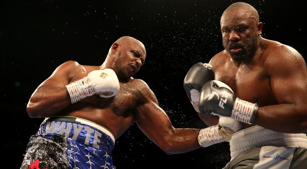 Dillian Whyte, left, defeated Dereck Chisora with an 11th-round knockout (Steven Paston/PA)
