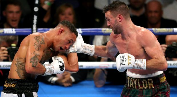 Josh Taylor (right) unified the super-lightweight division with a majority decision win over Regis Prograis at O2 Arena (Paul Harding/PA)