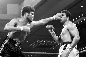 Leon Spinks lands a punch on Muhammad Ali in their 1978 title bout (AP)