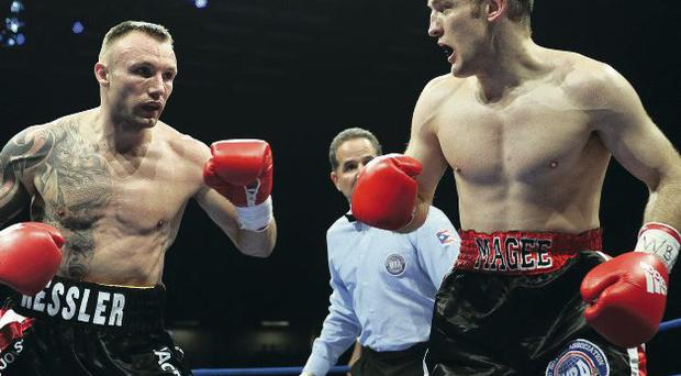 Difficult bout: Brian Magee in action with Mikkel Kessler