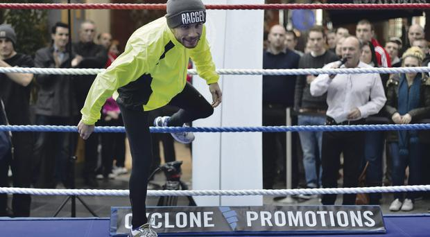 In demand: Carl Frampton gets into the ring for his open training session at Victoria Square