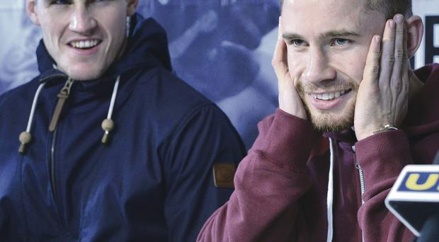 Coach Shane McGuigan and Carl Frampton share a joke at yesterday's press conference