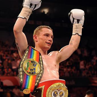 Carl Frampton set up a possible world title shot as a brutal body shot earned a comprehensive victory over France's Jeremy Parodi in Belfast on Saturday night.
