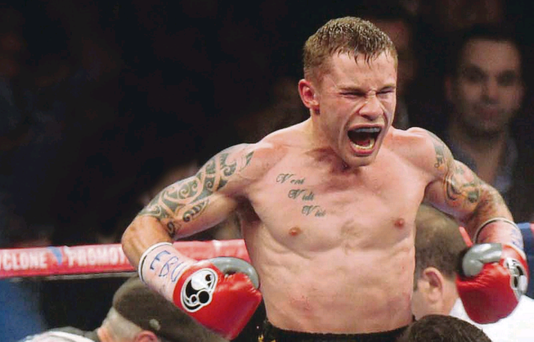Roaring success: Carl Frampton celebrates after his victory on Saturday night