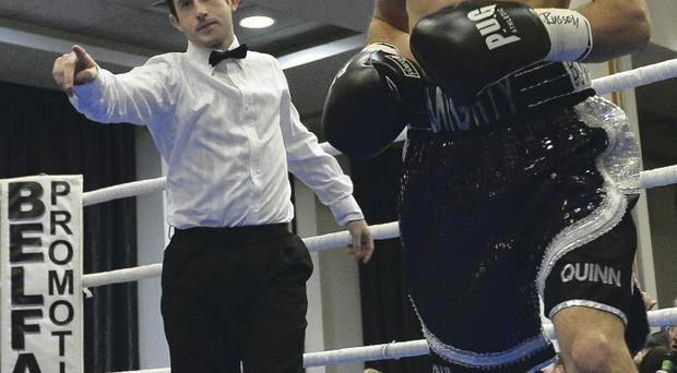 Still standing: Paul Quinn on way to victory over Sajid Khan