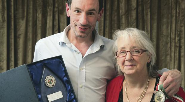 Mummy's boy: Stephen Kirk and mum Mary with the boxer's IABA Hall of Fame award and his World bronze medal