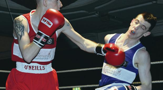Boxing clever: Ruairi Dalton, left, lands a blow on Sean Higginson on the way to winning the Ulster flyweight title