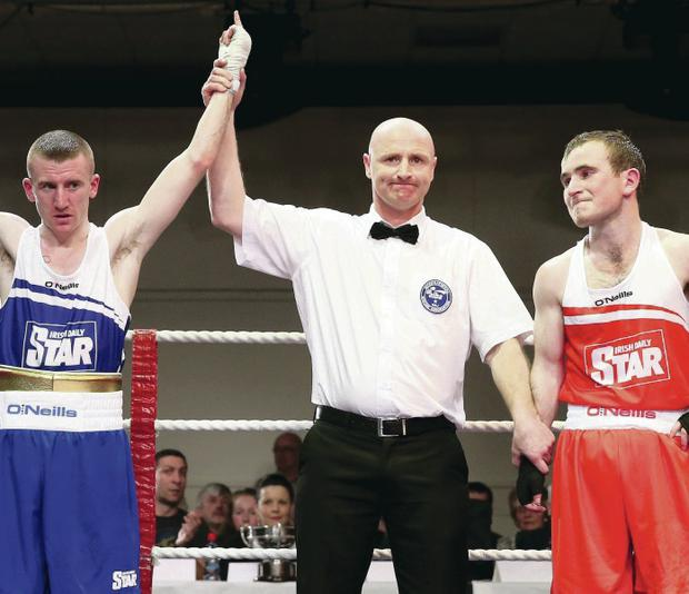 Paddy Barnes has his arm raised last night after beating Hughie Myers on a unanimous decision