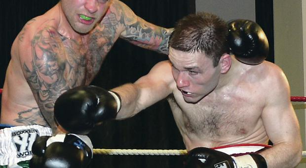 On top: Matthew Wilton (right) on way to victory against Lewie O'Mara at the Holiday Inn last night