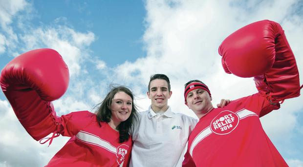 Glove affair: SSE Home Nation ambassador Michael Conlan joined SSE Airtricity staff Hannah Mark and Stephen McAvoy at their Belfast offices to help raise money for Sport Relief