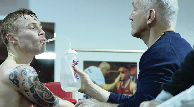 Drinkng it all in: Carl Frampton with his manager Barry McGuigan