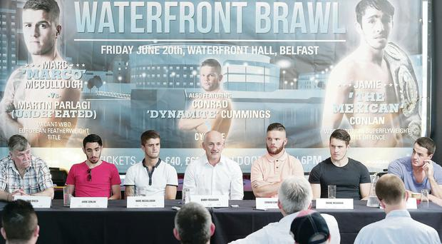 Raring to go: John Breen, Jamie Conlan, Marc McCullough, Barry McGuigan, Conrad Cummings, Shane McGuigan and Conall Carmichael line up in advance of the big fight night at the Waterfront Hall tonight. McCullough will clash with the unbeaten Martin Parlagi over 10 rounds