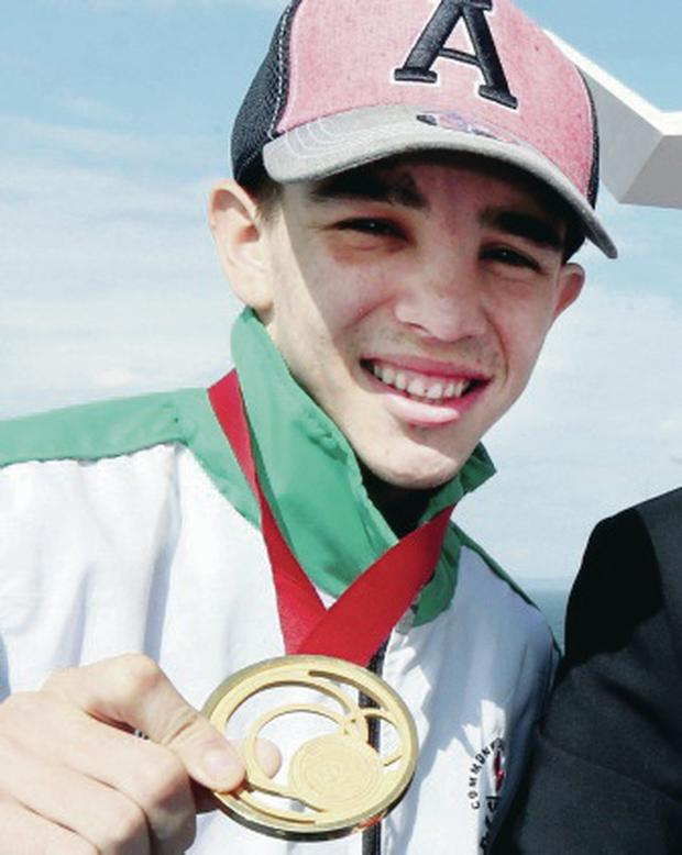 Golden boy: Michael Conlan returns home with his medal