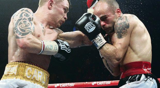 Last time: Carl Frampton and Kiko Martinez during their previous bout at the Odyssey Arena in Belfast