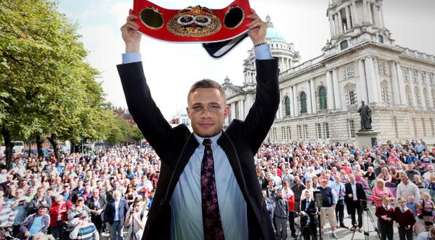 On top of world: Carl Frampton shows off his world title belt at a civic reception at Belfast City Hall