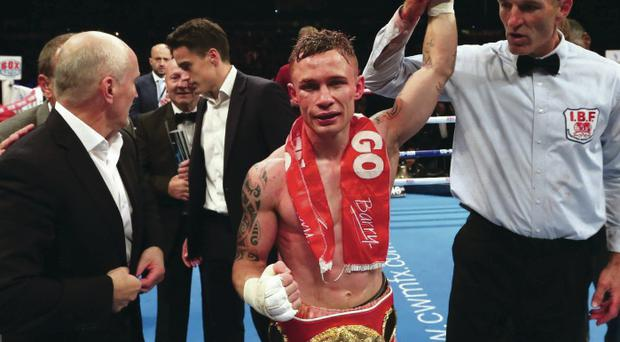Score to settle: New super-bantamweight champion Carl Frampton could fight in front of 25,000 fans at Windsor Park