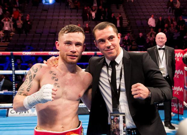 Check it out: Carl Frampton and Scott Quigg (right) in the ring at the Odyssey Arena back in February