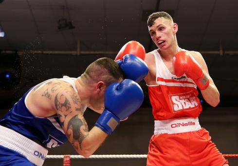 2014 Irish National Elite Championships Men's Finals 7/3/2014 60kg Sean McComb (Holy Trinity) vs David Oliver Joyce (St Michael?s Athy) Sean McComb (RED) in action against David Oliver Joyce (BLUE) Mandatory Credit ?INPHO/Cathal Noonan