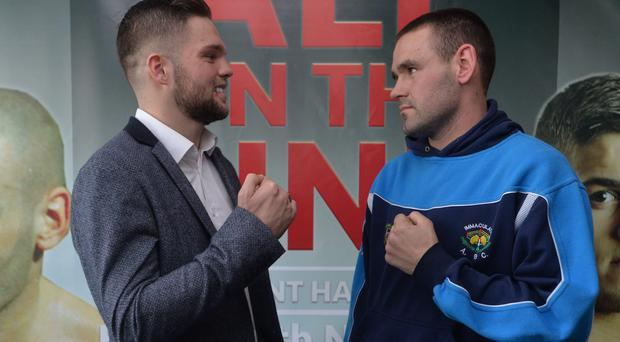 Bring it on: Conrad Cummings and Fredo Meli square up at yesterday's press conference in the Waterfront Hall