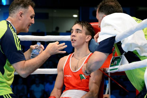 Winning combination: Billy Walsh with Belfast's Michael Conlan en route to winning Ireland's first World Championship gold in Doha