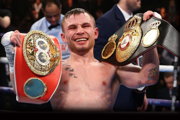 Two good: Carl Frampton celebrates with his two belts after his victory over Scott Quigg