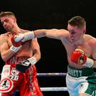 Prize fighter: Belfast's Ryan Burnett lands a powerful right hand on the chin of Anthony Settoul during his fight on Saturday night