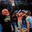 Just champion: Barry and Shane McGuigan celebrate the victory with Carl Frampton
