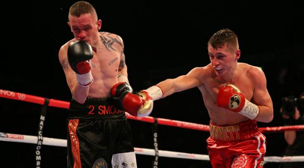 On the ropes: Ryan Burnett catches Jason Booth during their British Bantamweight bout in Manchester last year