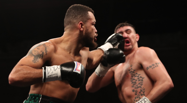 On the ropes: Tommy McCarthy (left) lands a blow on Matty Askin but it was the Blackpool man who won the contest