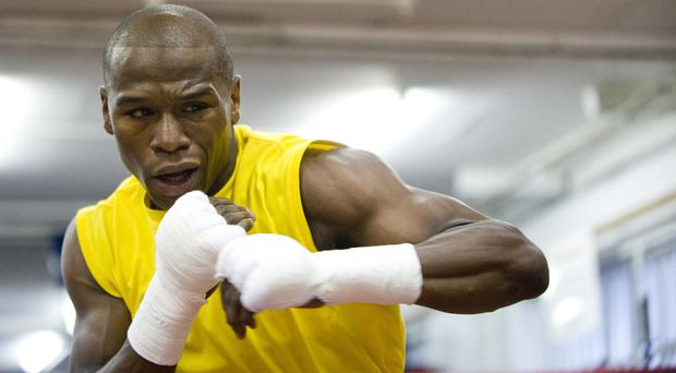 Floyd Mayweather, pictured, retired from boxing after a points win over Andre Berto in September 2015