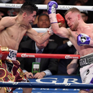All action: Leo Santa Cruz (left) and Carl Frampton battle it out in Las Vegas in late January