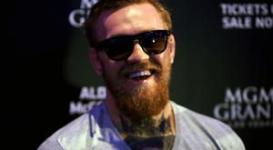 UFC champion Conor McGregor will take on five-division world champion boxer Floyd Mayweather in August.