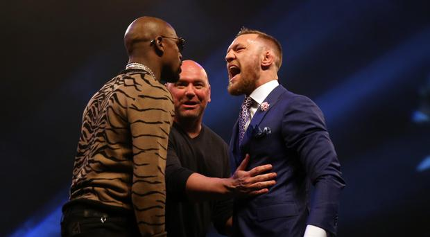 Conor McGregor, right, and Floyd Mayweather, left, will go head-to-head in the ring on August 26
