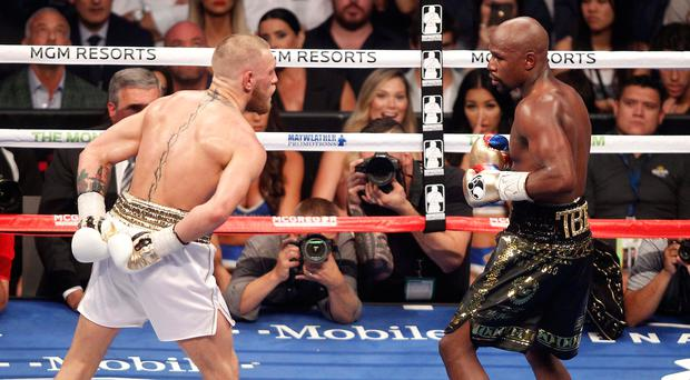 Showboat: Conor McGregor drops hands for Floyd Mayweather