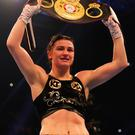 World beater: Katie Taylor celebrates victory in Cardiff