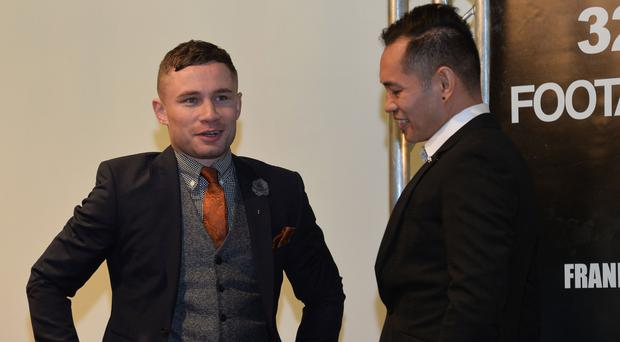 Fighting men: Carl Frampton and Nonito Donaire chat at the Europa Hotel yesterday