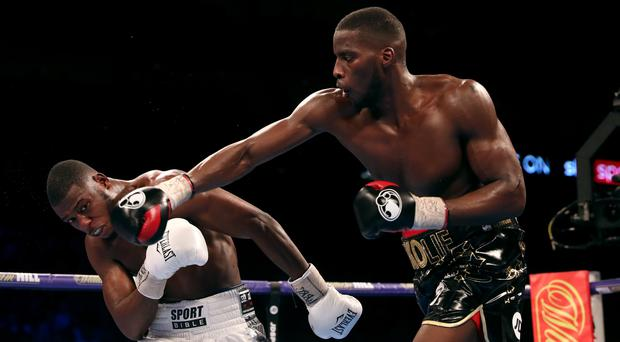 Lawrence Okolie (right) had too much power for Isaac Chamberlain during their cruiserweight clash (Lawrence Okolie/PA Images)