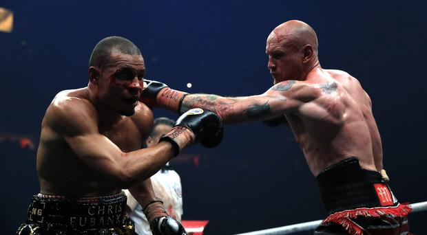 Chris Eubank,left, was outboxed by George Groves in Manchester