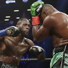 Deontay Wilder, left, survived a major scare before defeating Luis Ortiz (Frank Franklin II/AP)