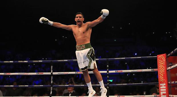 Amir Khan beat Phil Lo Greco inside 40 seconds on his return to the ring