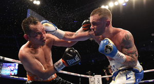 Strong show: Carl Frampton gets in a good shot against Nonito Donaire