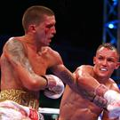 Lee Selby (left) in action against Josh Warrington during their IBF World Featherweight bout (Dave Thompson/PA)